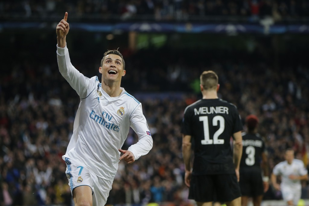 Real Madrid's Cristiano Ronaldo celebrates his side's 2nd goal during the Champions League soccer match, round of 16, 1st leg between Real Madrid and