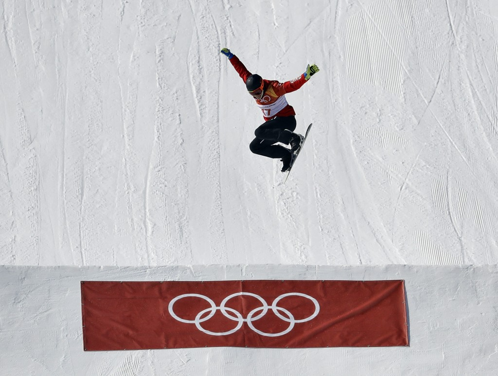 Kevin Hill, of Canada, jumps during the men's snowboard cross seeding at Phoenix Snow Park at the 2018 Winter Olympics in Pyeongchang, South Korea, Th