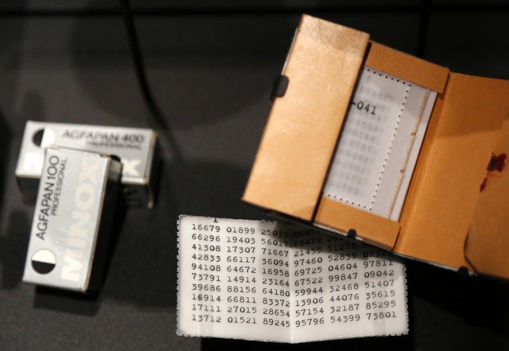 """In this Monday, Feb. 12, 2018 photo, a """"one-time pad,"""" used to encode messages, is displayed at SPYSCAPE in New York. Visitors to a new attraction ope"""