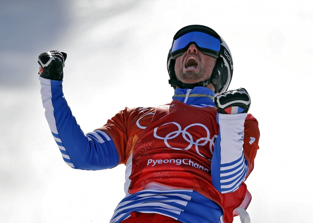 Pierre Vaultier, of France, celebrates after winning gold during the men's snowboard cross final at Phoenix Snow Park at the 2018 Winter Olympics in P...
