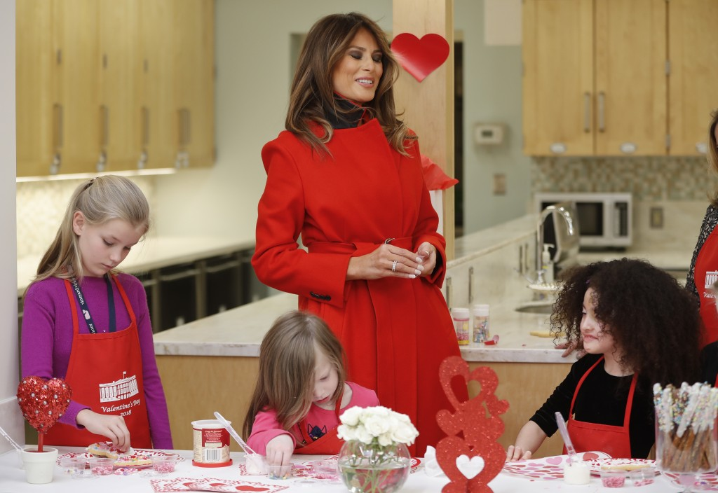 First lady Melania Trump speaks with Amber Negrete, 8, right seated, during her visit to the Children's Inn at the National Institute of Health, Wedne