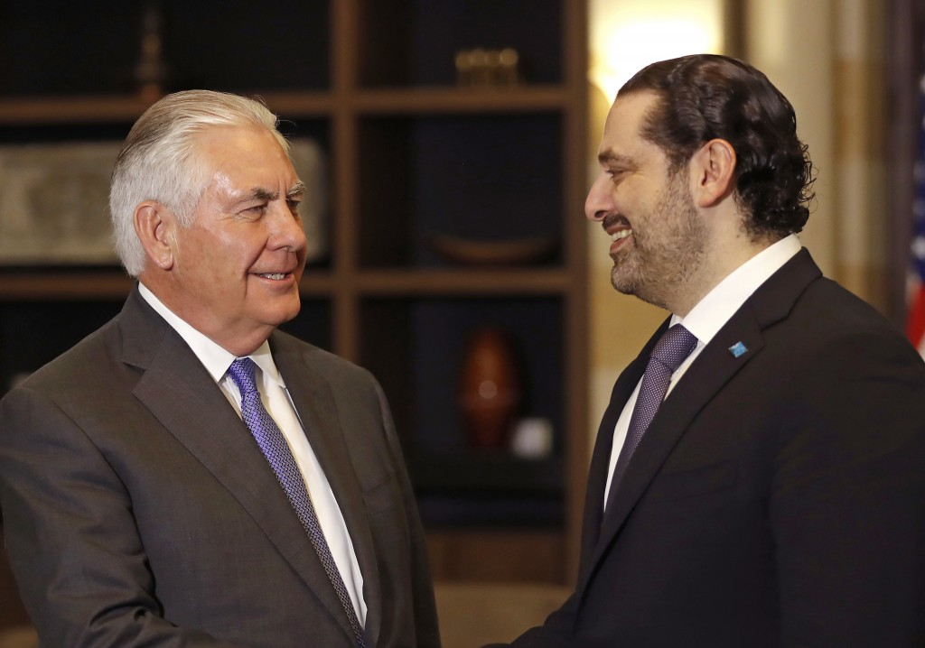 Lebanese Prime Minister Saad Hariri, right, speaks with U.S. Secretary of State Rex Tillerson, at the Government House, in Beirut, Lebanon, Thursday,