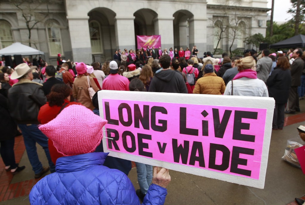 FILE - In this Jan. 22, 2018 file photo, supporters attend a rally held by Planned Parenthood, commemorating the 45th anniversary of the landmark Roe