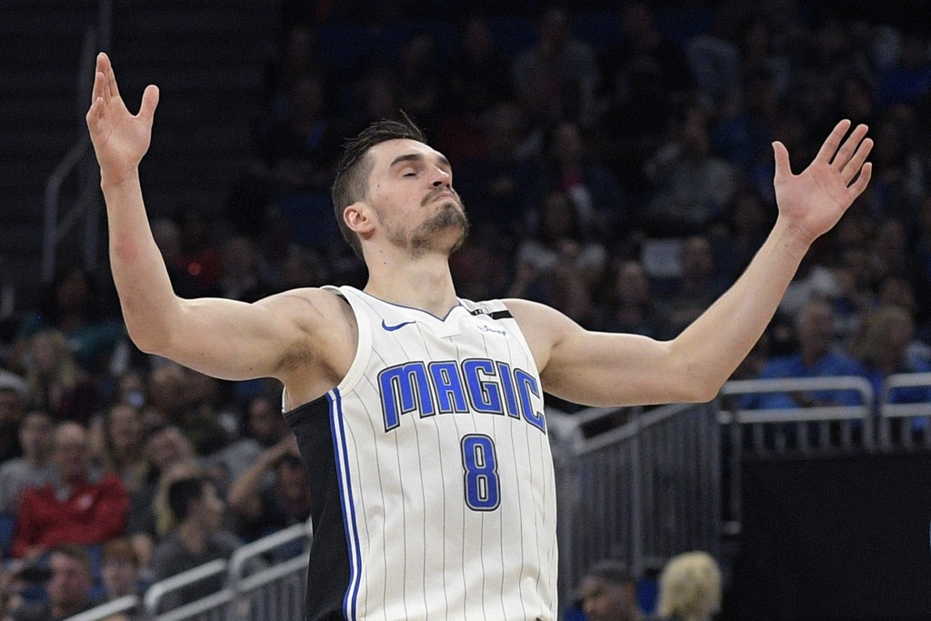 Orlando Magic guard Mario Hezonja reacts after sinking a 3-pointer during the first half of the team's NBA basketball game against the Charlotte Horne