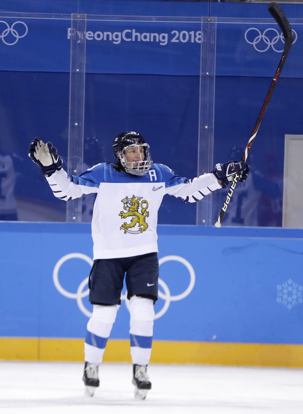 Riikka Valila (13), of Finland, reacts after scoring a goal on the Olympic Athletes from Russia during the second period of a preliminary round women'