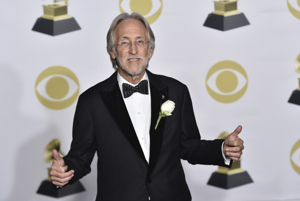 FILe - In this Jan. 28, 2018 file photo, President of The Recording Academy Neil Portnow poses in the press room at the 60th annual Grammy Awards in N