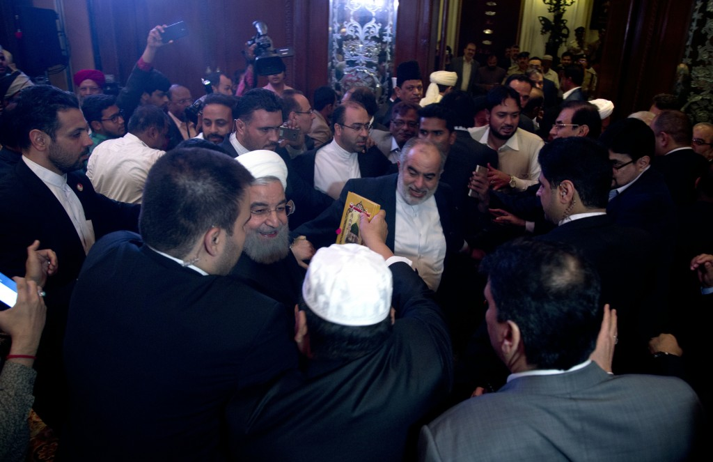Iranian President Hassan Rouhani, center,meets with Muslims leaders and scholars in Hyderabad, India, Thursday, Feb. 15, 2018. Rouhani arrived in the