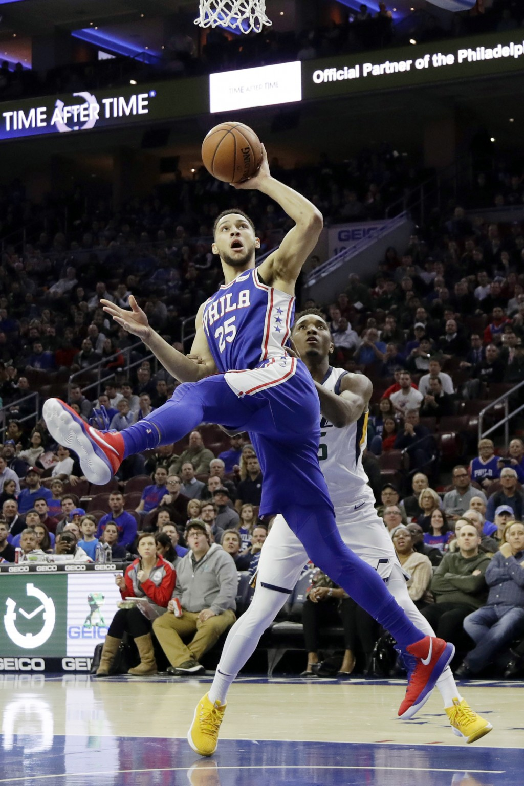 FILE - In this Nov. 20, 2017, file photo, Philadelphia 76ers' Ben Simmons, left, goes up for a shot against Utah Jazz's Donovan Mitchell, right, durin