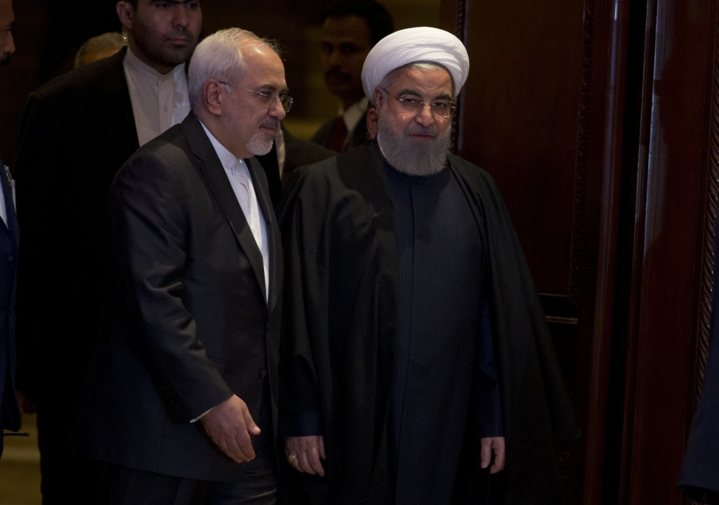 Iranian President Hassan Rouhani, right, with Iran Foreign Affairs Minister Mahamad Javad Zarief, arrive during a meeting with Muslim leaders and scho