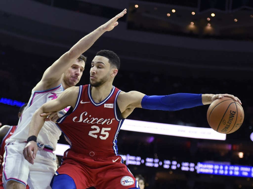 FILE- In this Feb. 14, 2018, file photo, Philadelphia 76ers' Ben Simmons (25) drives to the basket around Miami Heat's Goran Dragic (7) in the second