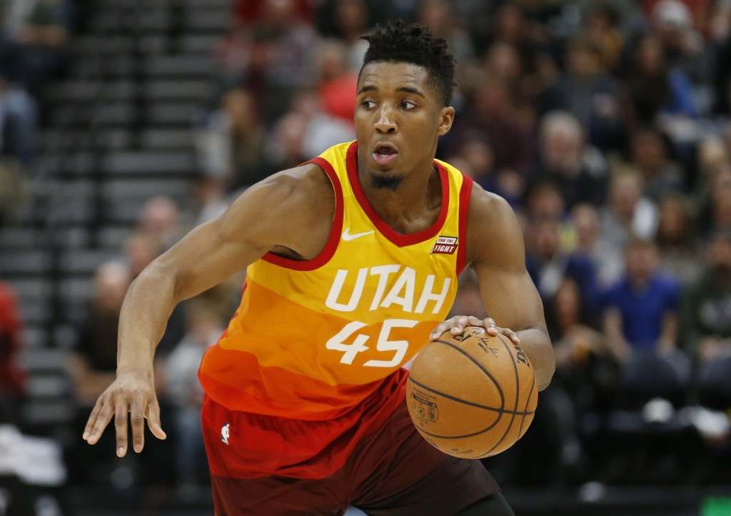 FILE- In this Feb. 9, 2018, file photo, Utah Jazz guard Donovan Mitchell (45) drives up court in the second half during an NBA basketball game against
