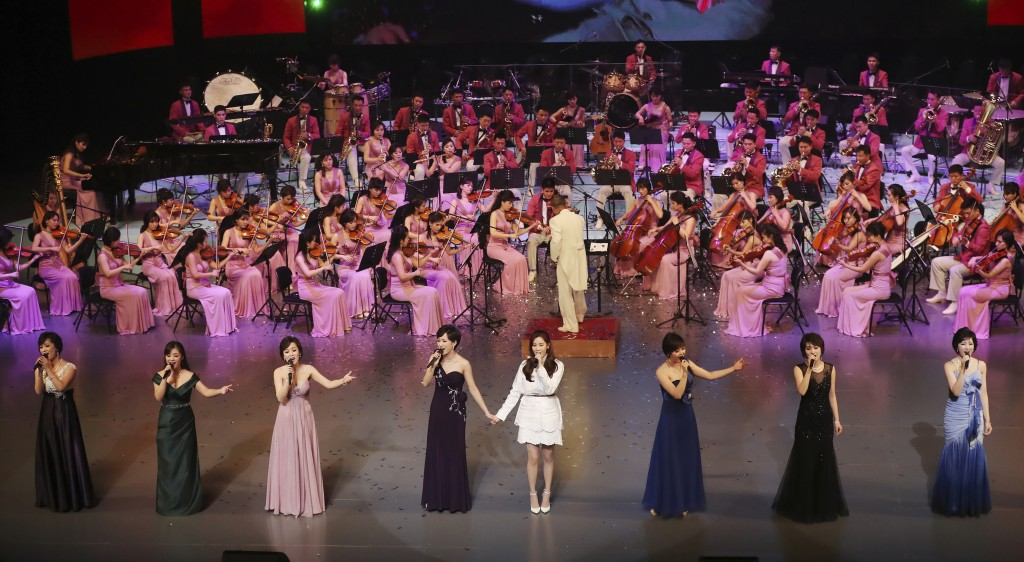 FILE - In this Feb. 11, 2018 file photo provided by South Korea Presidential Blue House, South Korean singer Seo Hyun, bottom center, sings the song, ...