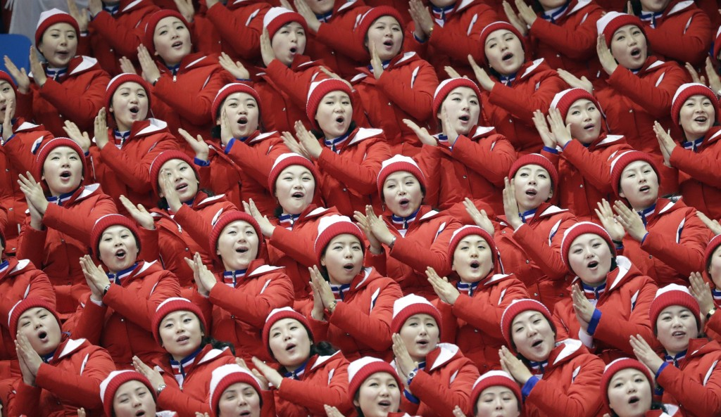 North Korean supporters sing ahead of the pairs free skate figure skating final in the Gangneung Ice Arena at the 2018 Winter Olympics in Gangneung, S...