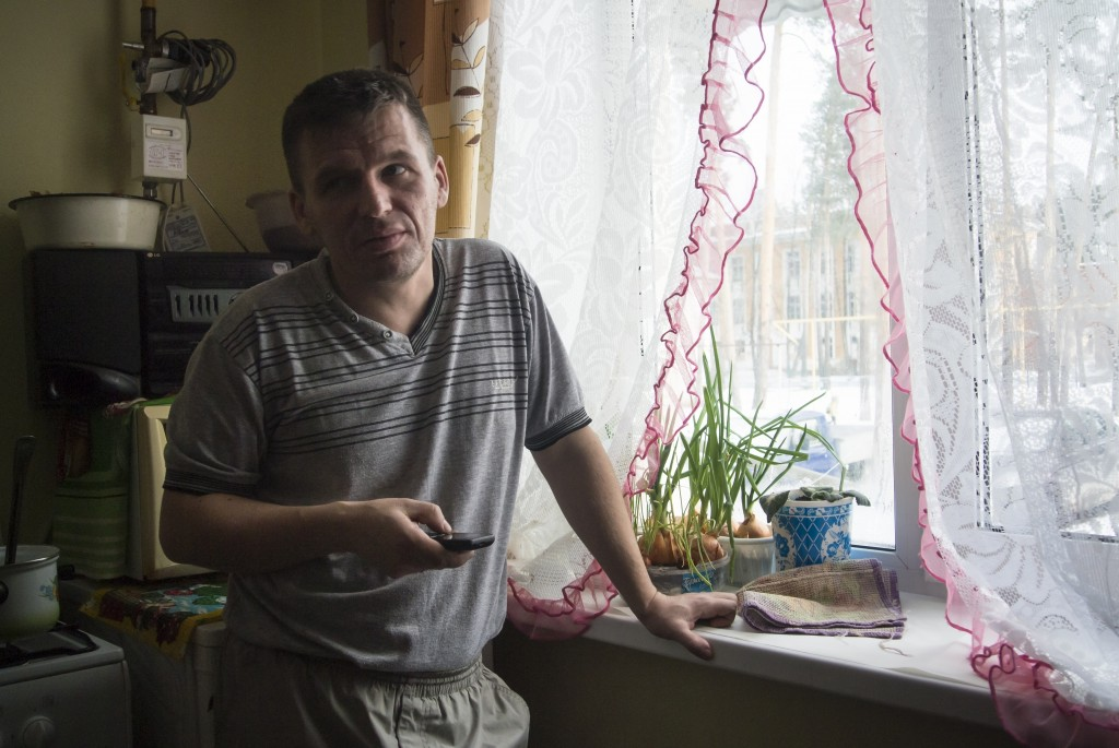 Yevgeny Berdyshev, half-brother of Alexander Potapov who is believed to be fighting in Syria, stands at the window at his home in the village of Kedro