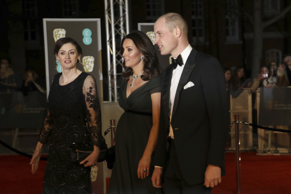 Britain's Kate, the Duchess of Cambridge, centre, and William, Duke of Cambridge, right, arrive with Chief Executive of BAFTA Amanda Berry at the BAFT...