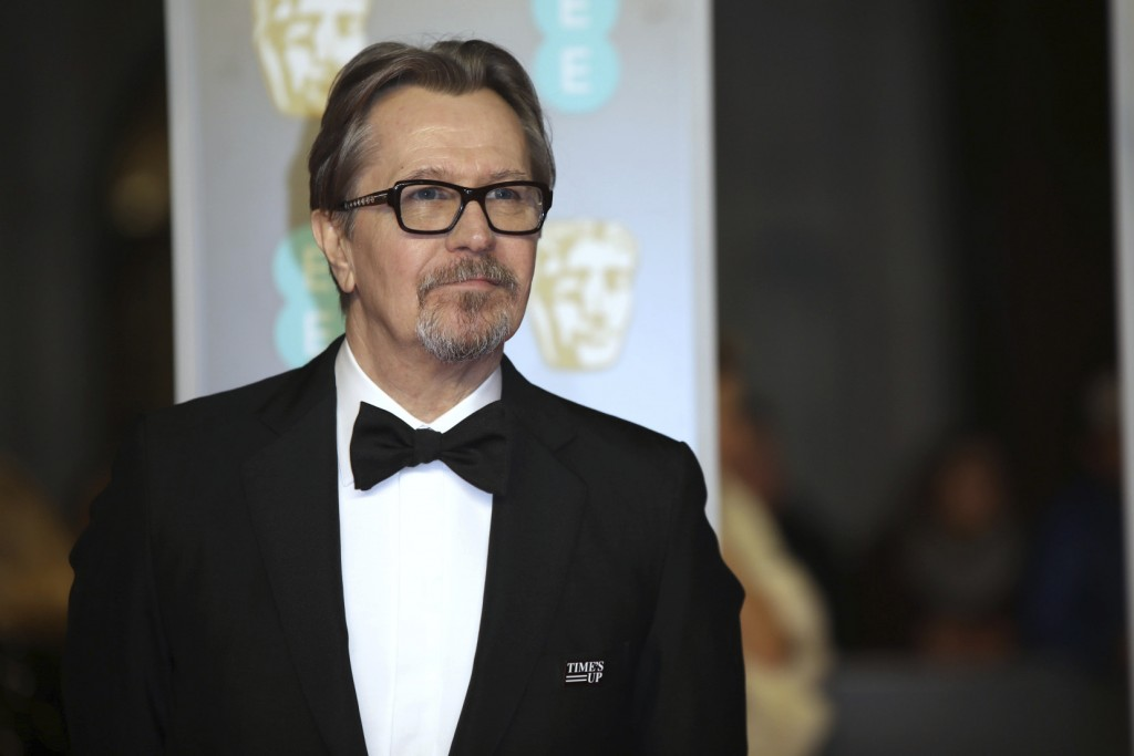 Actor Gary Oldman poses for photographers upon arrival at the BAFTA Awards 2018 in London, Sunday, Feb. 18, 2018. (Photo by Vianney Le Caer/Invision/A...