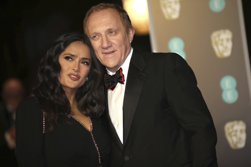 Actress Salma Hayek and husband Francois-Henri Pinault pose for photographers upon arrival at the BAFTA Awards 2018 in London, Sunday, Feb. 18, 2018. ...
