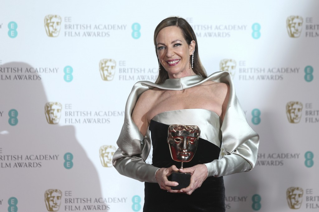 Actress Allison Janney poses with her award for Best Actress for 'I, Tonya' backstage at the BAFTA 2018 Awards in London, Sunday, Feb. 18, 2018. (Phot...
