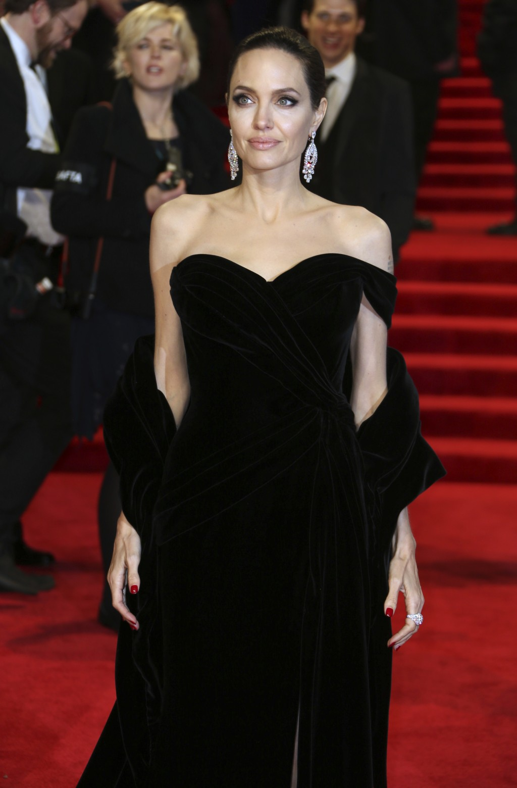 Actress Angelina Jolie poses for photographers upon arrival at the BAFTA 2018 Awards in London, Sunday, Feb. 18, 2018. (Photo by Joel C Ryan/Invision/...