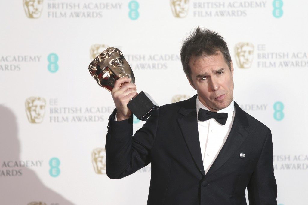 Actor Sam Rockwell poses with his Best Supporting Actor award for 'Three Billboards Outside Ebbing, Missouri' backstage at the BAFTA 2018 Awards in Lo...