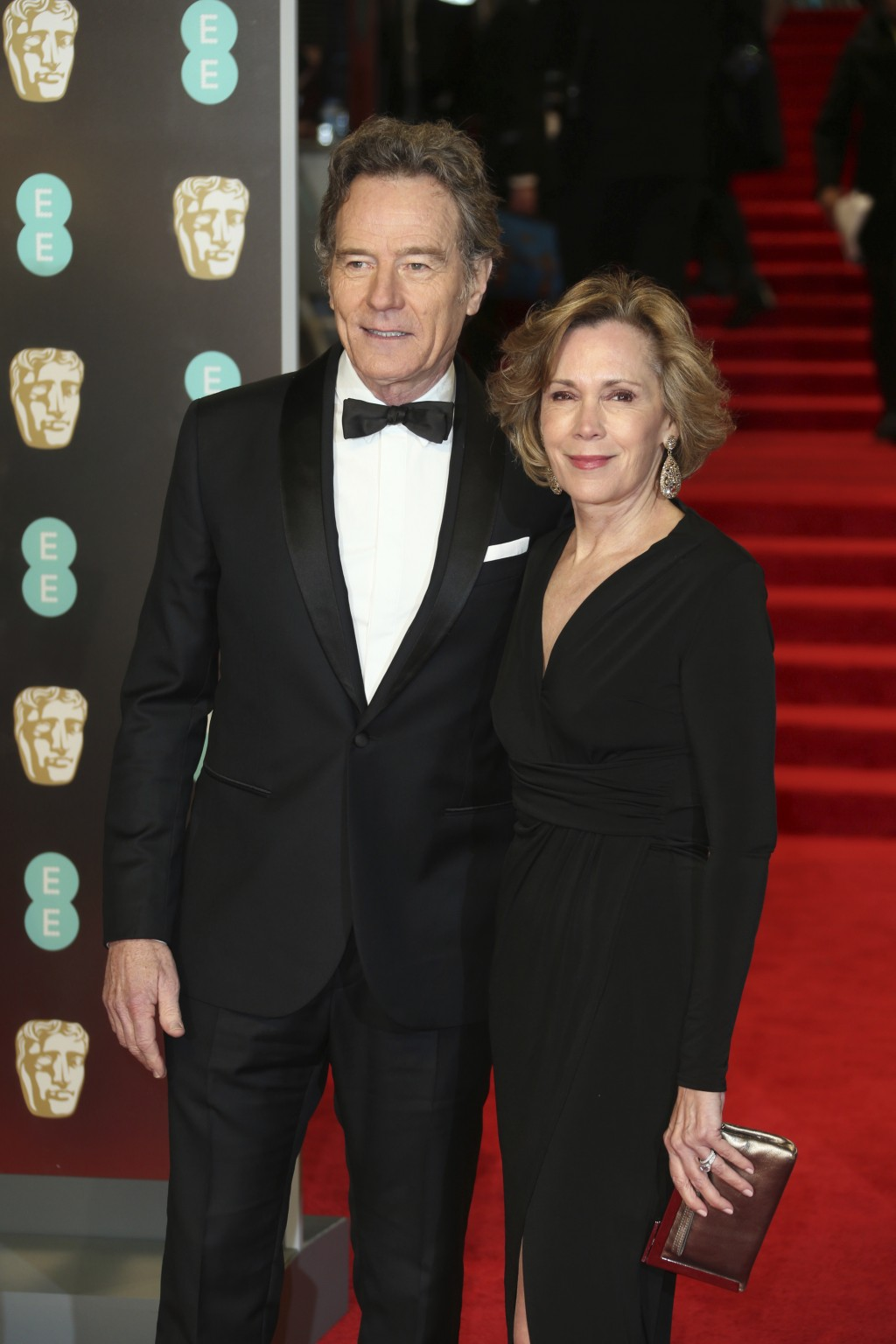 Actor Bryan Cranston and Robin Dearden pose for photographers upon arrival at the BAFTA 2018 Awards in London, Sunday, Feb. 18, 2018. (Photo by Joel C...