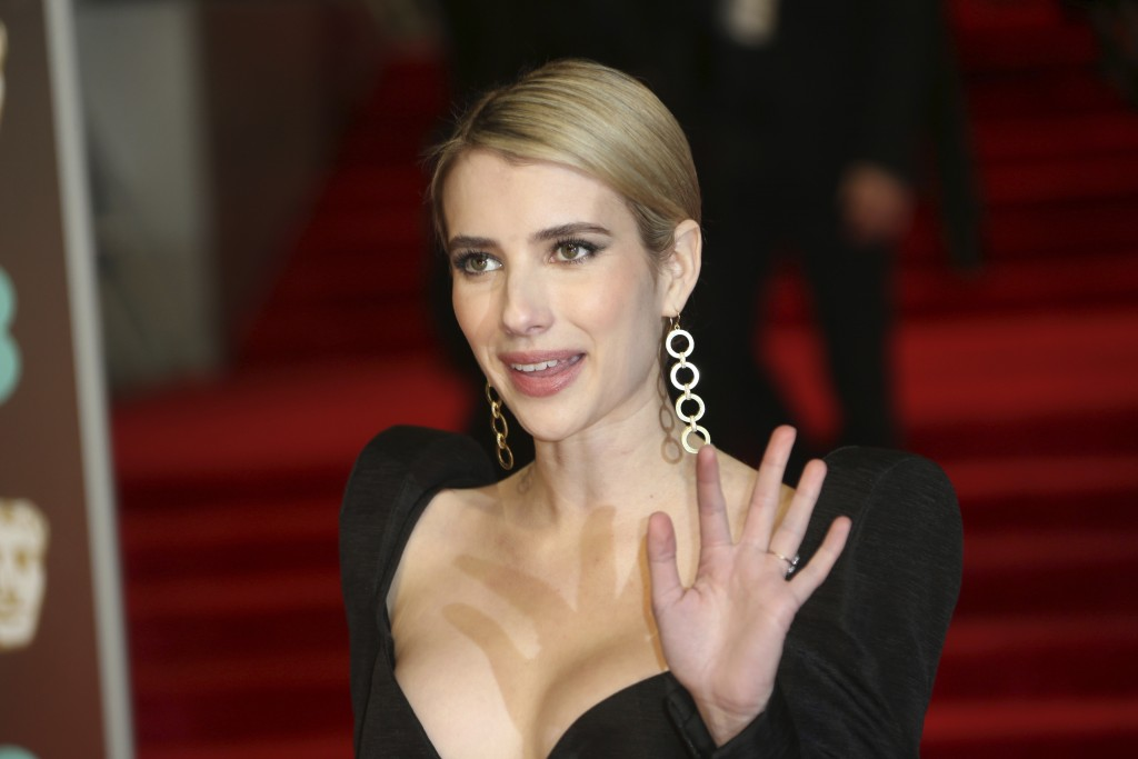 Actress Emma Roberts poses for photographers upon arrival at the BAFTA 2018 Awards in London, Sunday, Feb. 18, 2018. (Photo by Joel C Ryan/Invision/AP...