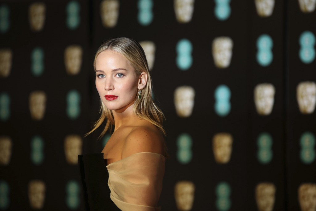 Actress Jennifer Lawrence poses for photographers upon arrival at the BAFTA Awards 2018 in London, Sunday, Feb. 18, 2018. (Photo by Vianney Le Caer/In...