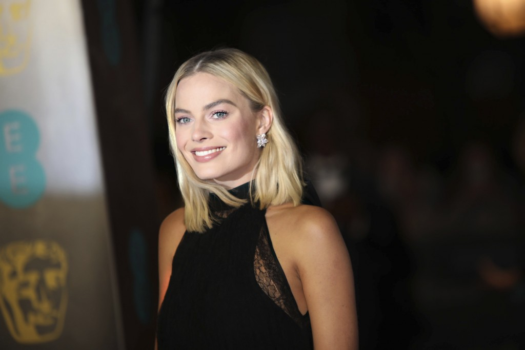 Actress Margot Robbie poses for photographers upon arrival at the BAFTA Awards 2018 in London, Sunday, Feb. 18, 2018. (Photo by Vianney Le Caer/Invisi...