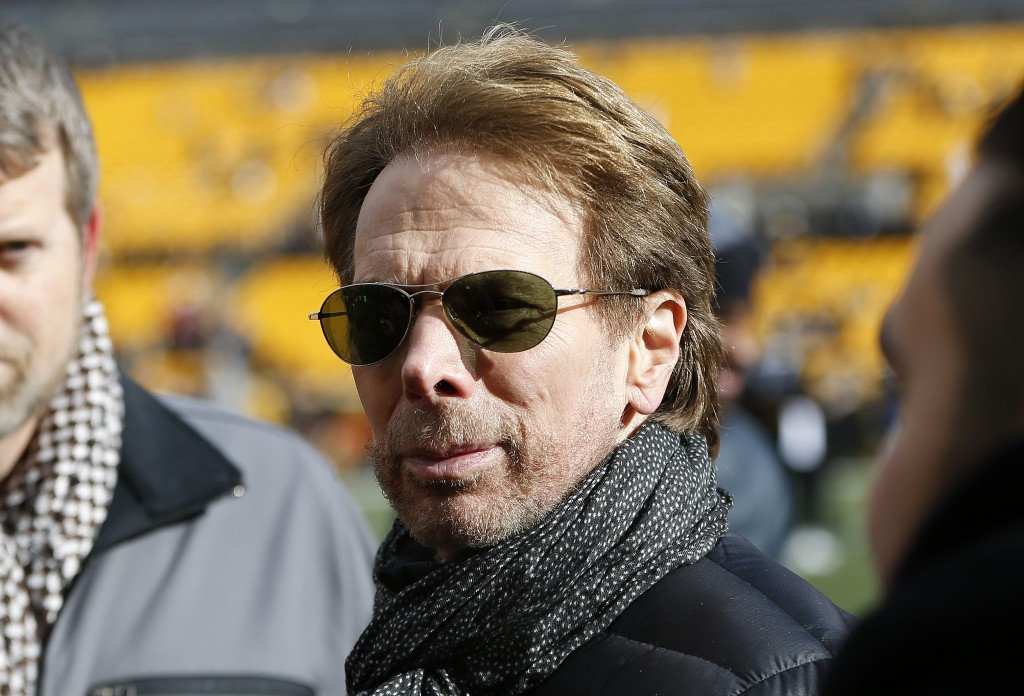 FILE - In this Sunday, Jan. 14, 2018 file photo, movie producer Jerry Bruckheimer stands on the sidelines before an NFL divisional football AFC playof...
