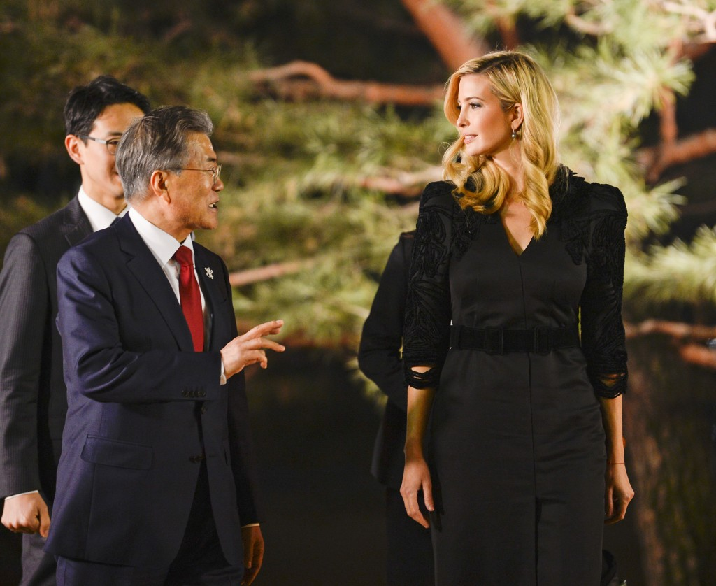 In this Feb. 23, 2018 photo, South Korean President Moon Jae-in talks with Ivanka Trump during their dinner at the Presidential Blue House, Seoul, Sou...