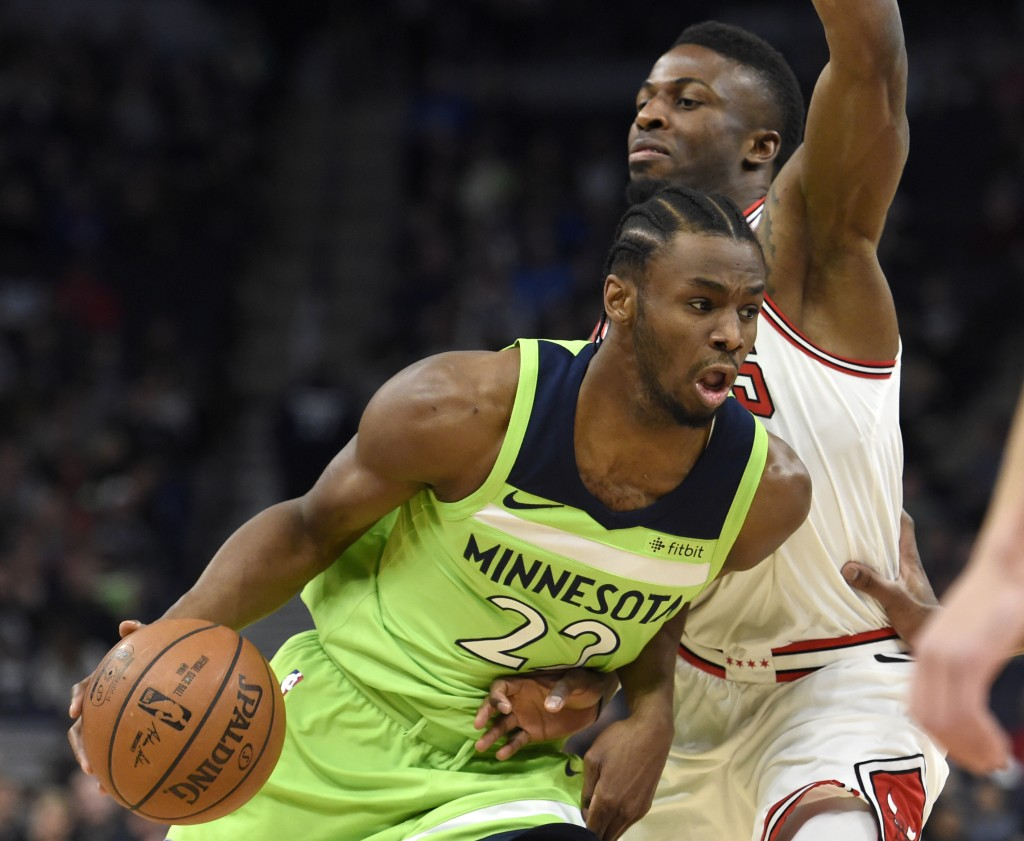 Minnesota Timberwolves' Andrew Wiggins (22) drives against Chicago Bulls' David Nwaba during the first quarter of an NBA basketball game on Saturday, ...