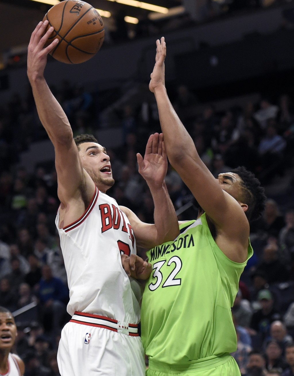 Chicago Bulls' Zach LaVine (8) shoots against Minnesota Timberwolves' Karl-Anthony Towns (32) during the fourth quarter of an NBA basketball game on S...