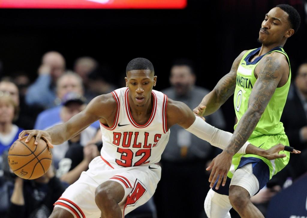 Minnesota Timberwolves' Jeff Teague (0) guards Chicago Bulls' Kris Dunn (32) during the first quarter of an NBA basketball game on Saturday, Feb. 24, ...