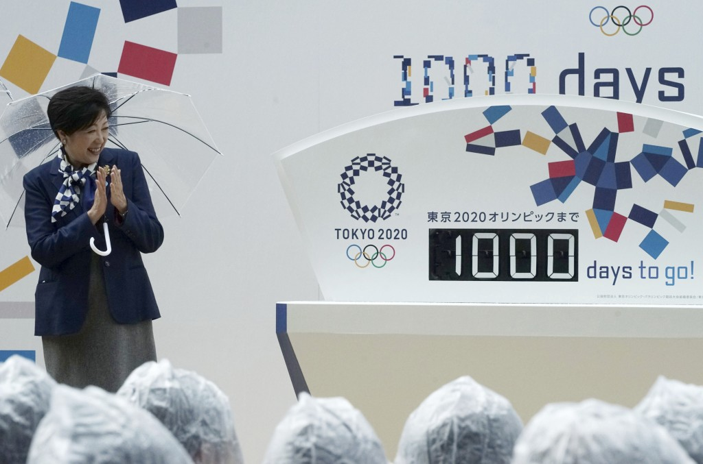 FILE - In this Oct. 28, 2017, file photo, Tokyo Gov. Yuriko Koike claps while looking at the day counter after it's unveiled during a Tokyo 2020 Olymp...