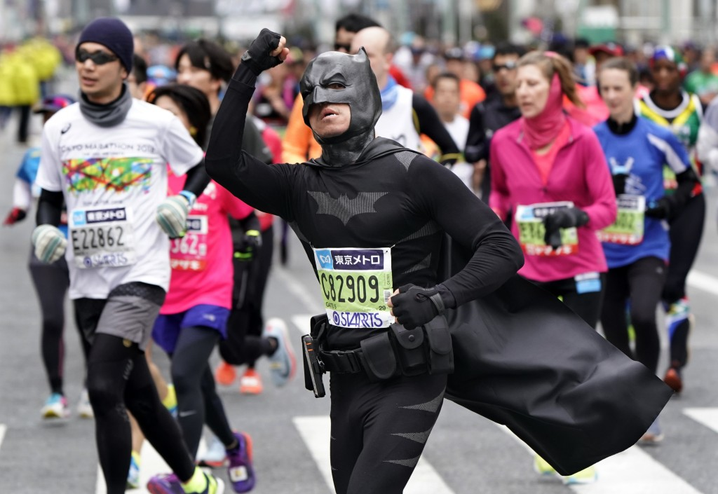 In this Feb. 25, 2018 photo, a runner in a Batman costume makes his way during the Tokyo Marathon in Tokyo. About 36,000 people participated in the an...