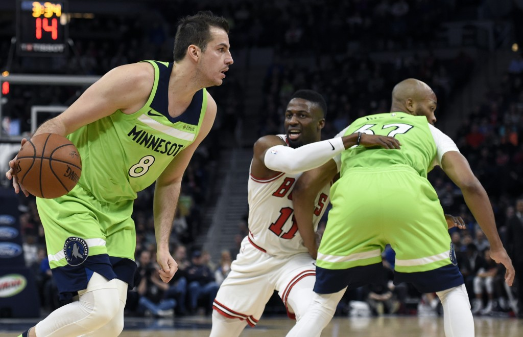 Minnesota Timberwolves' Nemanja Bjelica (8), of Serbia, drives as teammate Taj Gibson (67) sets a pick for Chicago Bulls' David Nwaba (11) during the ...