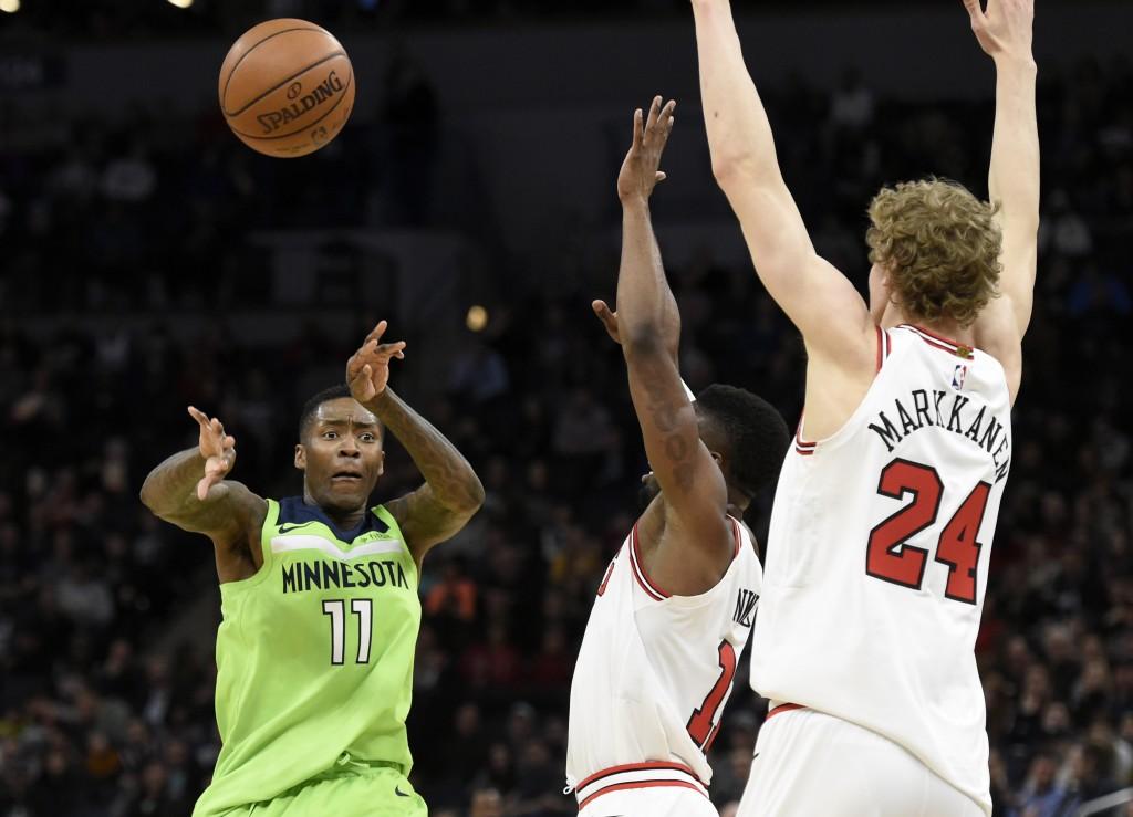 Minnesota Timberwolves' Jamal Crawford (11) passes the ball away from Chicago Bulls' David Nwaba (11) and Lauri Markkanen (24), of Finland, during the...
