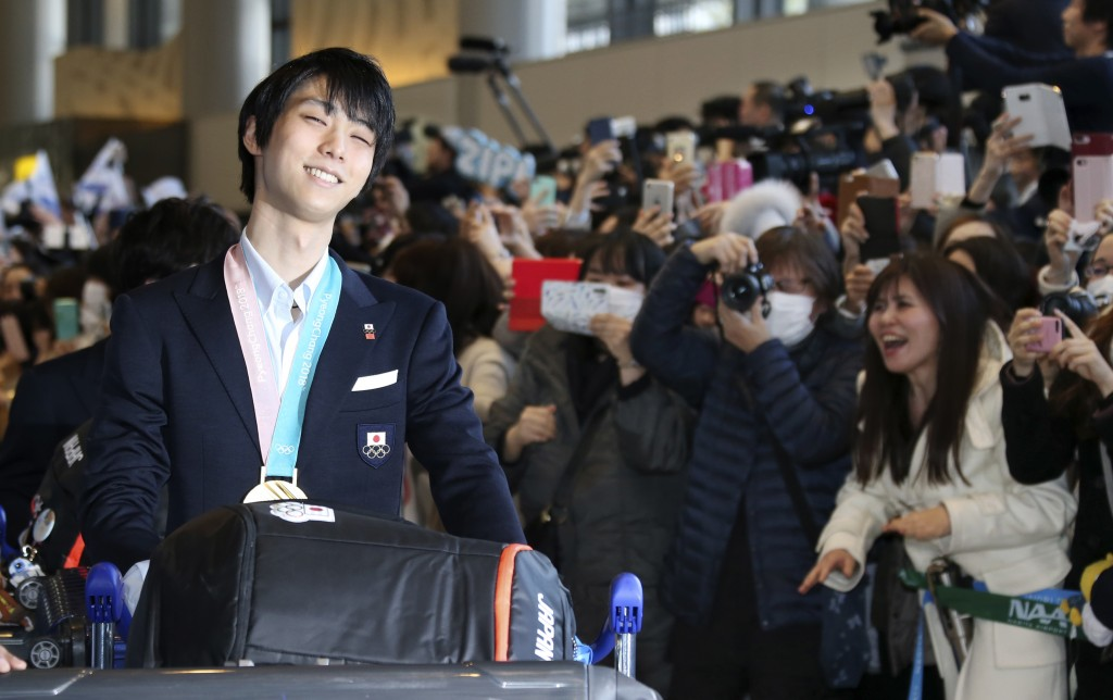 In this Feb. 26, 2018 photo, Japanese figure skater and gold medalist Yuzuru Hanyu arrives at Narita international airport in Narita, near Tokyo, as J...