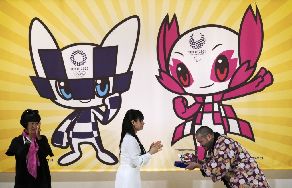 In this Feb. 28, 2018 photo, Ryo Taniguchi, right, the designer of the characters which will serve as mascots for the Tokyo 2020 Olympic Games and Par...