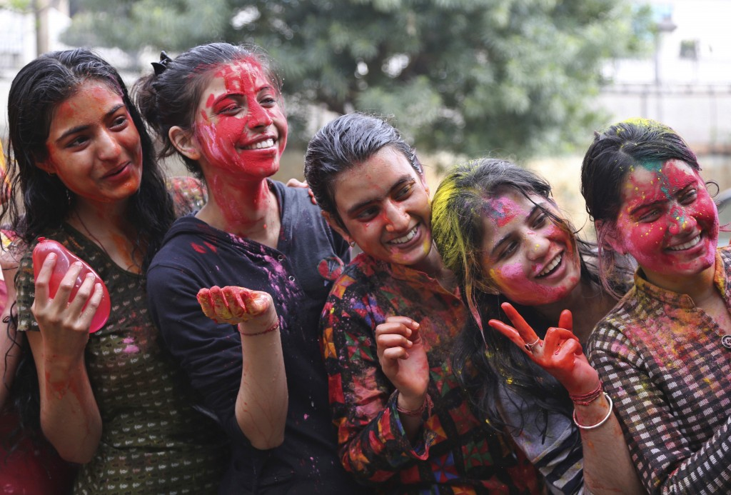 Local girls strike a pose as they play with colored powder during Holi in Jammu, India, Thursday, March 1, 2018. Holi, the Hindu festival of colors. (...
