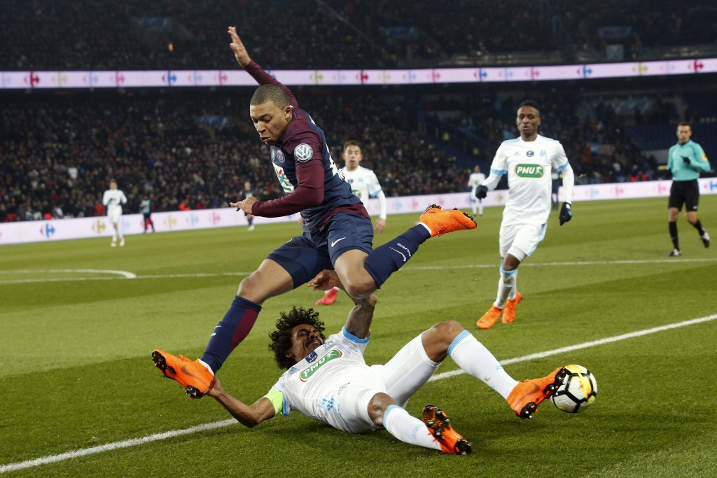 PSG s Kylian Mbappe challenges for the ball with Marseille s Luiz Gustavo  Dias during the French Cup 24fe0b376