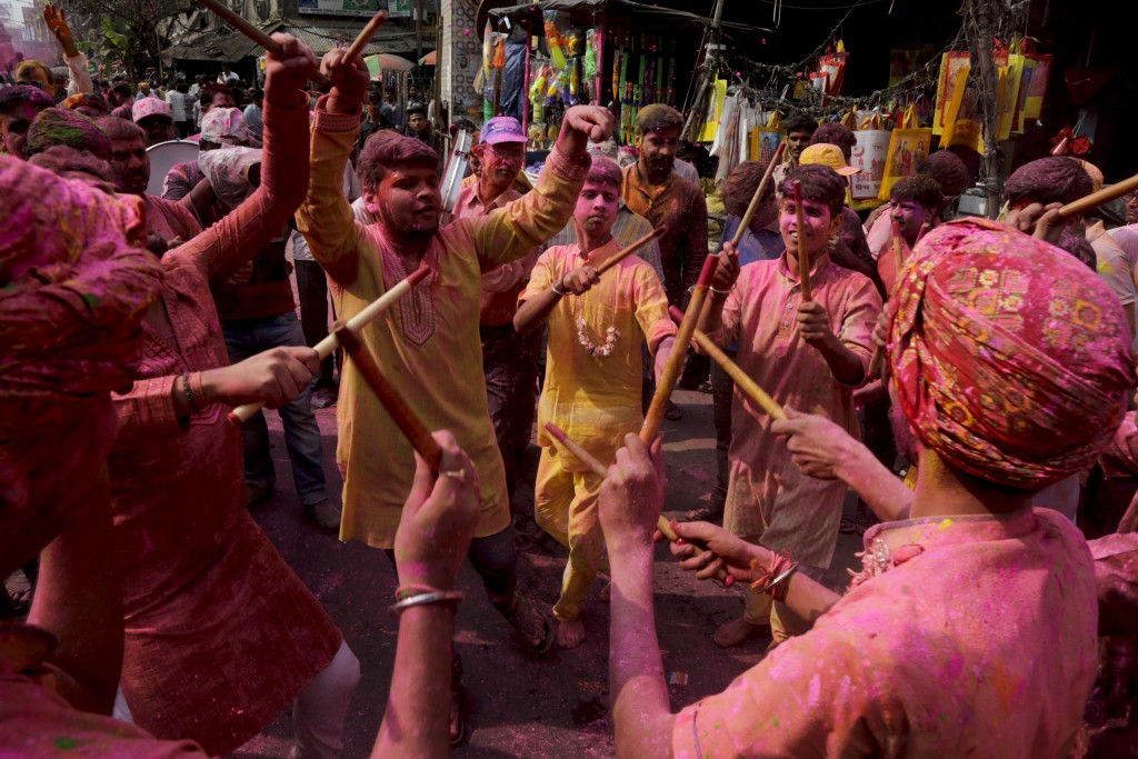 Locals dance on a street and celebrate Holi in Kolkata, India, Wednesday, Feb. 28, 2018. The festival also heralds the coming of spring. (AP Photo/Bik...