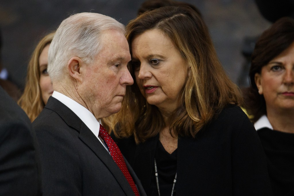 Attorney General Jeff Sessions talks with Senate staffer Sharon Soderstrom before the arrival of President Donald Trump to a ceremony honoring Reveren...