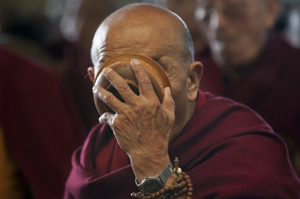 In this March 1, 2018 photo, an exile Tibetans Buddhist monk drinks Tibetan butter tea during the special prayers for the long life of the Tibetan spi...