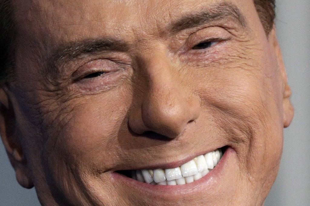 FILE - In this Thursday, Jan. 11, 2018 file photo, former Italian Premier and Forza Italia (Go Italy) party leader Silvio Berlusconi smiles during the