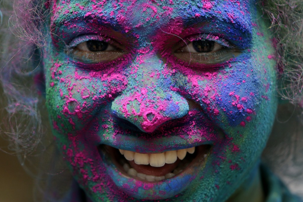 A girl's face is smeared in color as she celebrates Holi, the Hindu festival of colors, in Mumbai, India, Friday, March. 2, 2018. (AP Photo/Rajanish K...