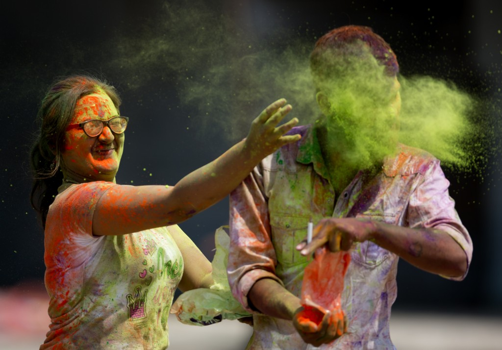 Indians throw colored powder on each other during Holi festival celebrations in Hyderabad, India, Friday, March 2, 2018. (AP Photo /Mahesh Kumar A.)