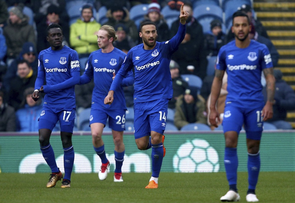 Everton's Cenk Tosun, centre, celebrates scoring his side's first goal of the game during their English Premier League soccer match at Turf Moor, Burn...