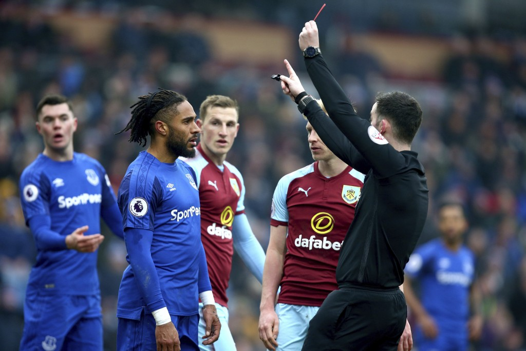 Everton's Ashley Williams, 2nd left, receives a red card from Referee Chris Kavanagh during the match against Burnley during their English Premier Lea...