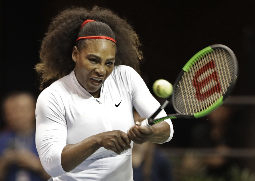 FILE - In this Feb. 11, 2018, file photo, United States' Serena Williams returns a shot against the Netherlands during a doubles match in the first ro...